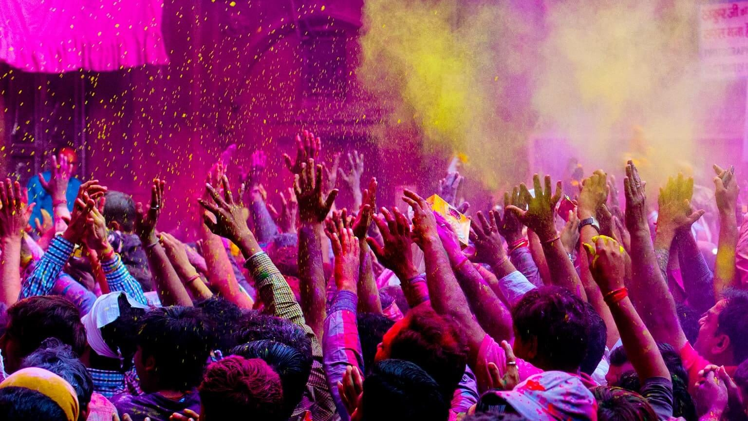 People enjoying Holi festival outdoors in India