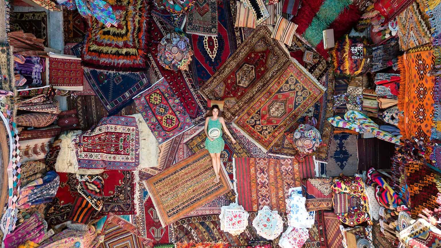 woman lying in carpets in a foreign shop