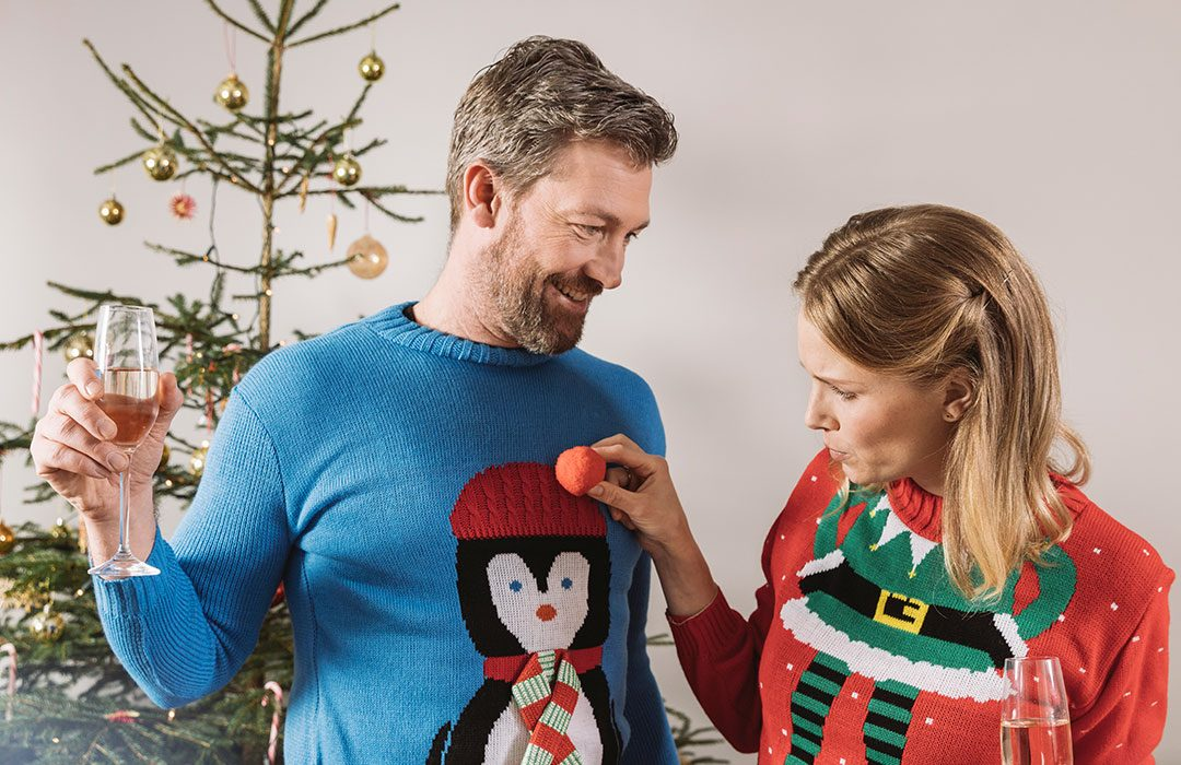 Couple In Christmas Sweaters