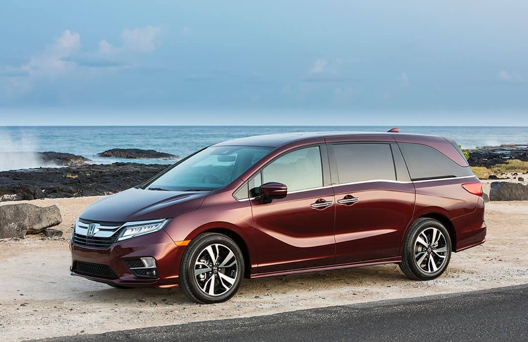 Honda Odyssey 2019 with the view of a beach at the background
