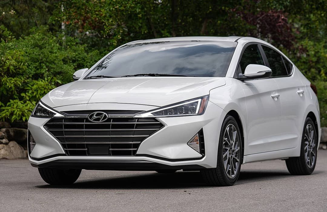 Hyundai Elantra 2019 on the road with trees at the background