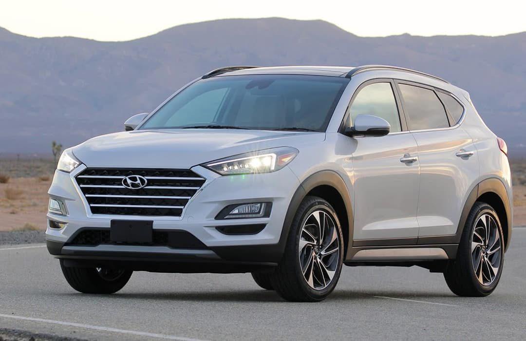Hyundai Tucson 2019 with a mountain behind