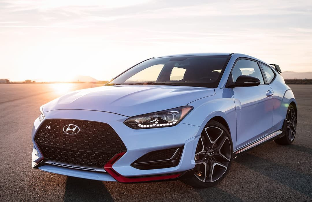 Hyundai Veloster 2019 in an open road with  a sunset background