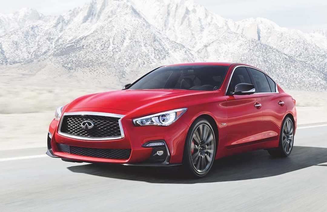 Infiniti Q50 2019 car with a snowy mountain at the background