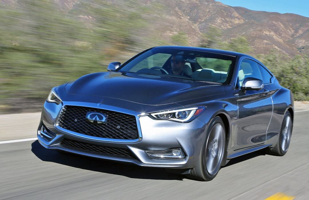 Infiniti Q60 2019 in motion on a highway