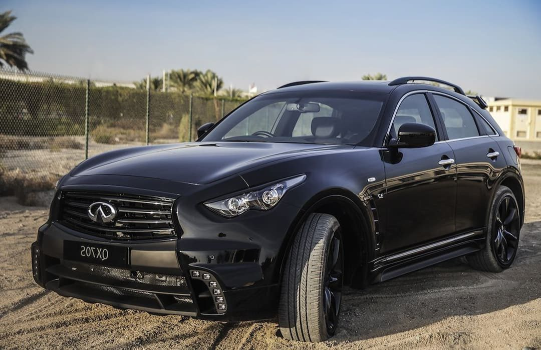 Infiniti QX70 2019 car parked in a sandy lot
