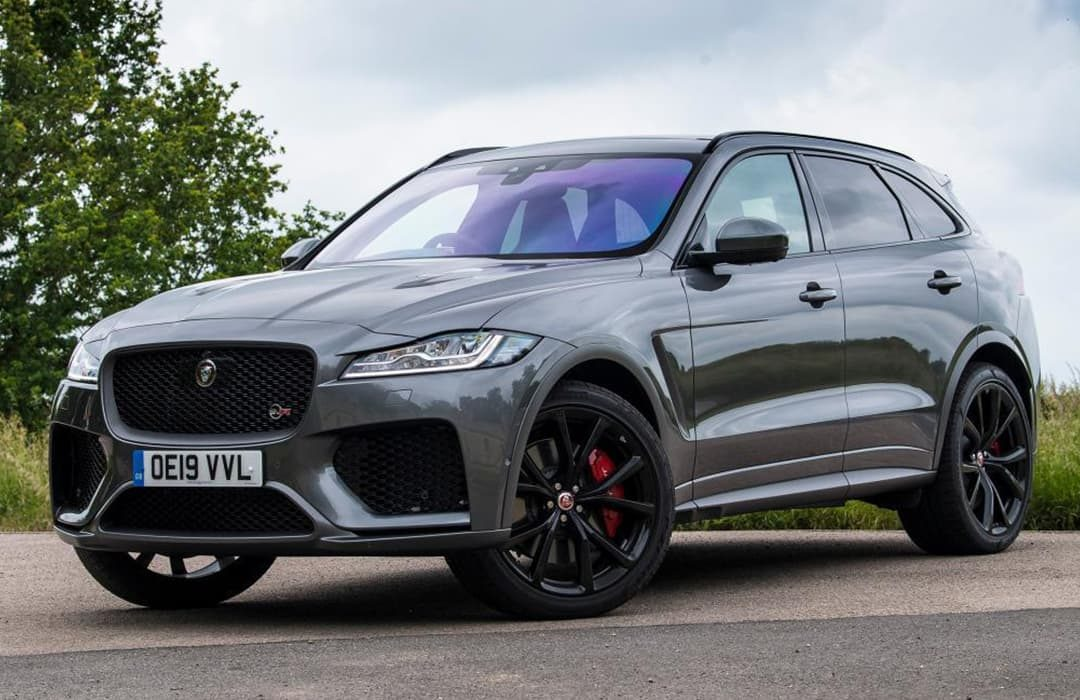 Jaguar F-Pace 2019 car on a road with trees and grass in the background