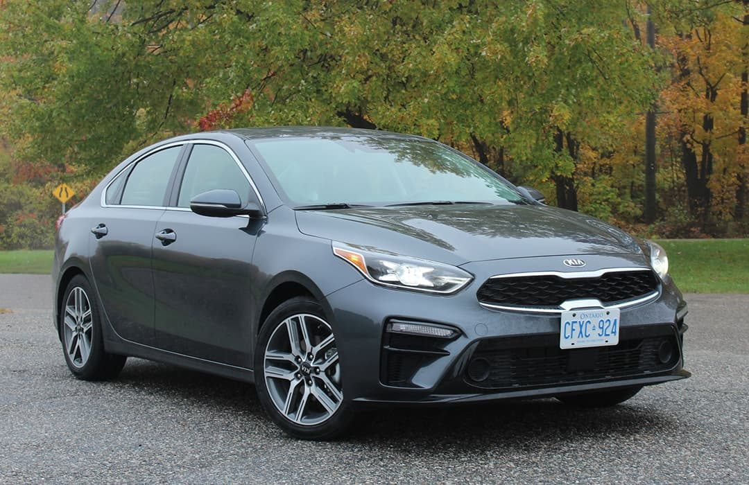 Kia Forte 2019 parked with trees at the background
