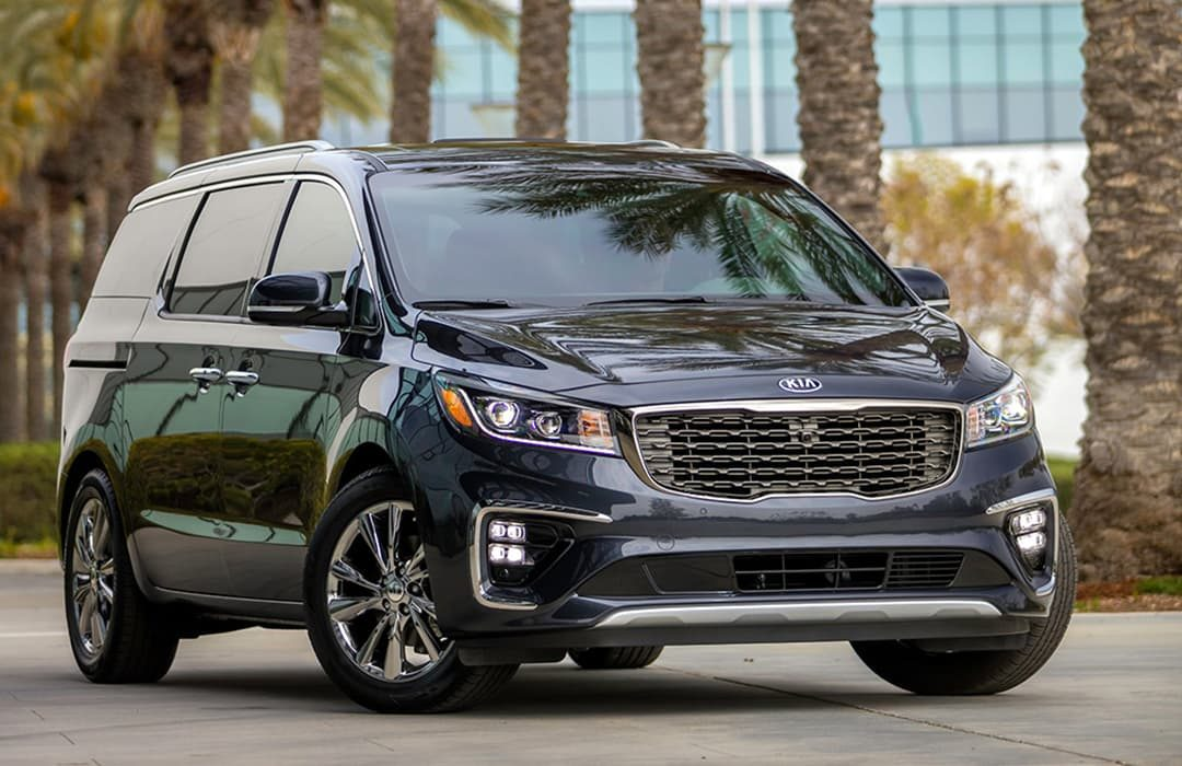 Kia Sedona 2019 in a highway with trees at the background