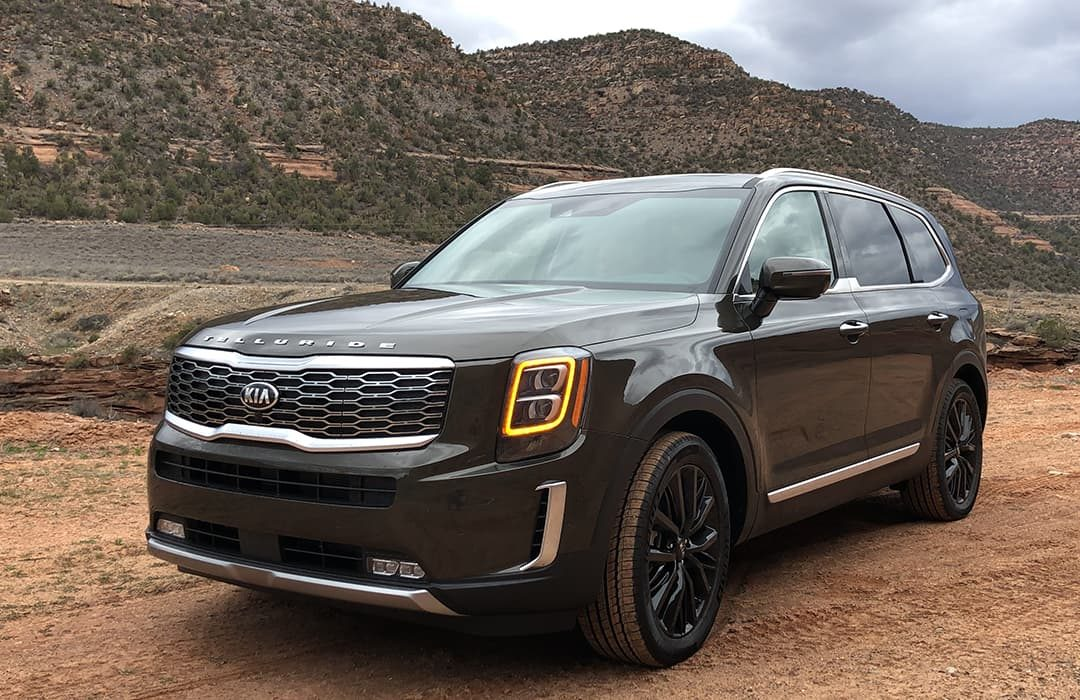 Kia Telluride 2019 car in an outback setting with mountain at the background