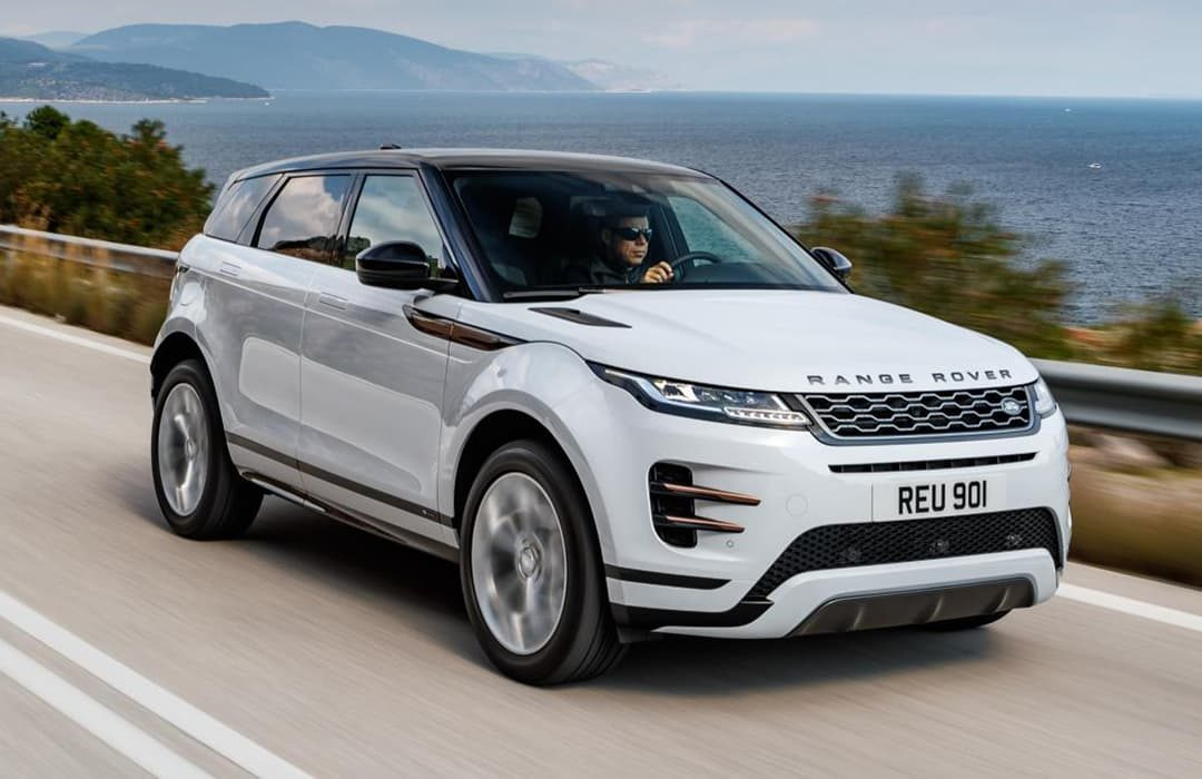 Land Rover Range Rover Evoque car in motion on a highway with the view of the sea at the back