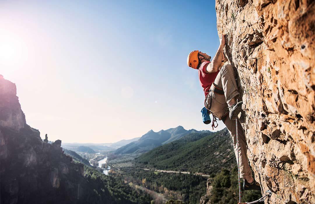 Rock climber climbing a mountain