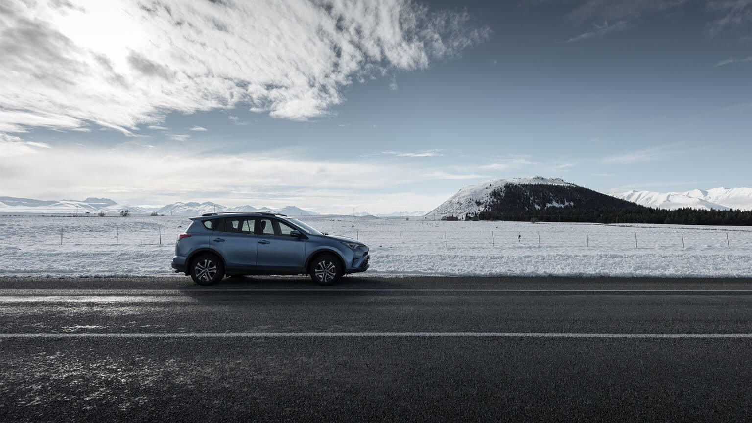 Car with a snowy backdrop