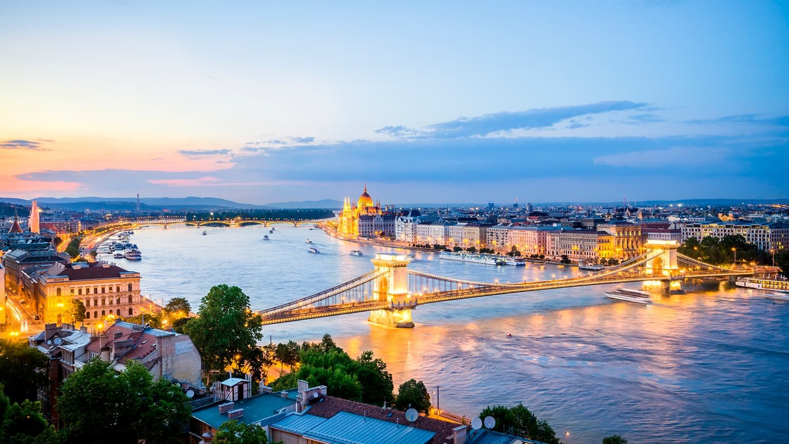 Budapest, Chain Bridge over Danube River and Hungarian Parliament Building.