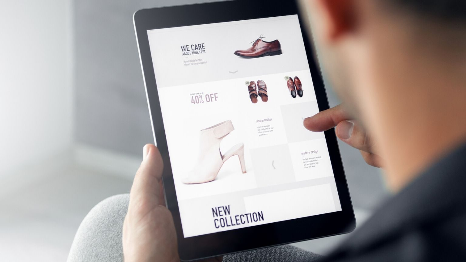 Man looking at an online shoe store