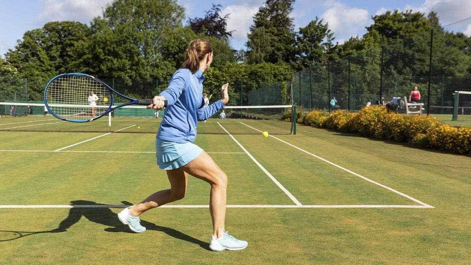 Woman during a tennis match on grass court