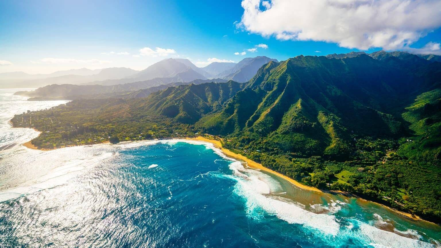 Aerial view of mountains and sea in Hawaii