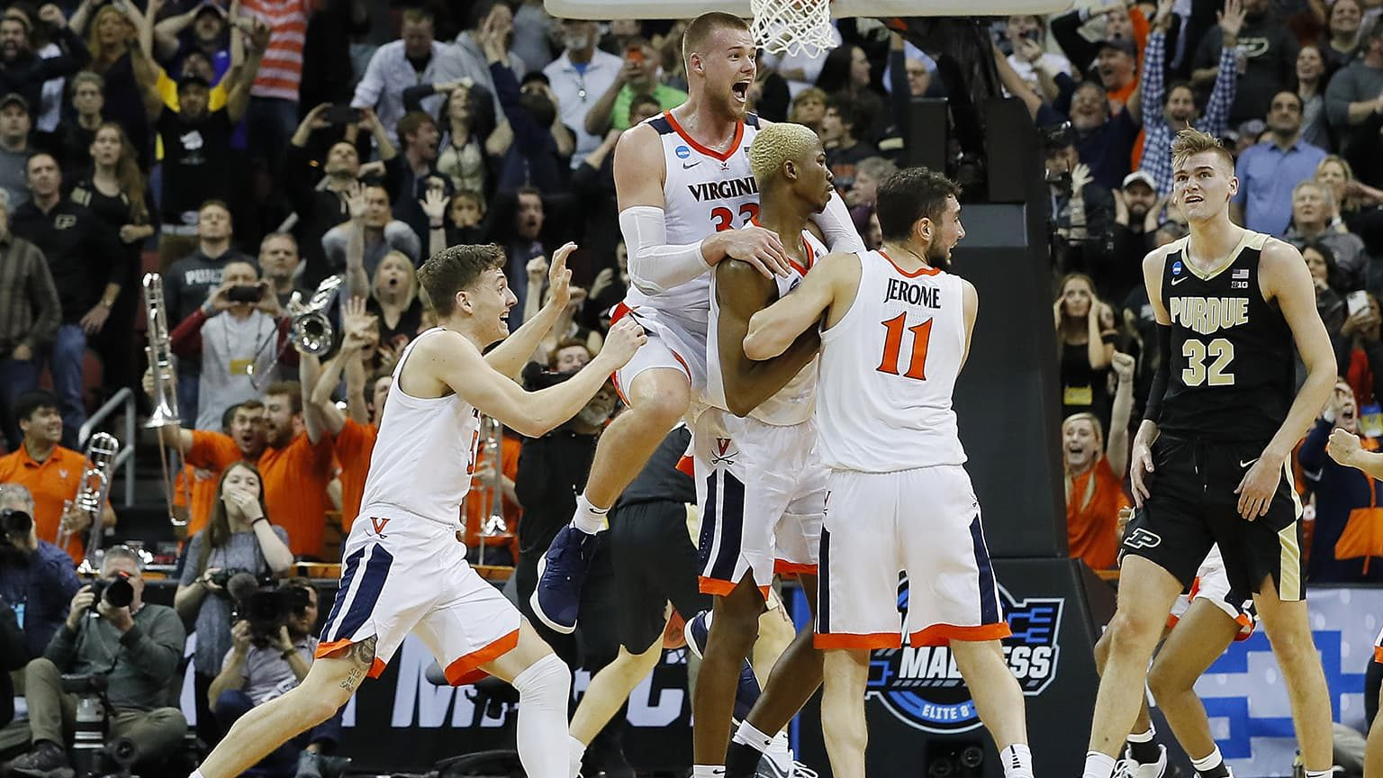 Virginia Cavaliers celebrates with teammates 2019 NCAA Men's Basketball Tournament South Regional at KFC YUM! Center on March 30, 2019
