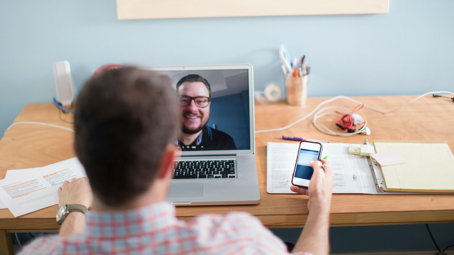 Two men having a video conference call.