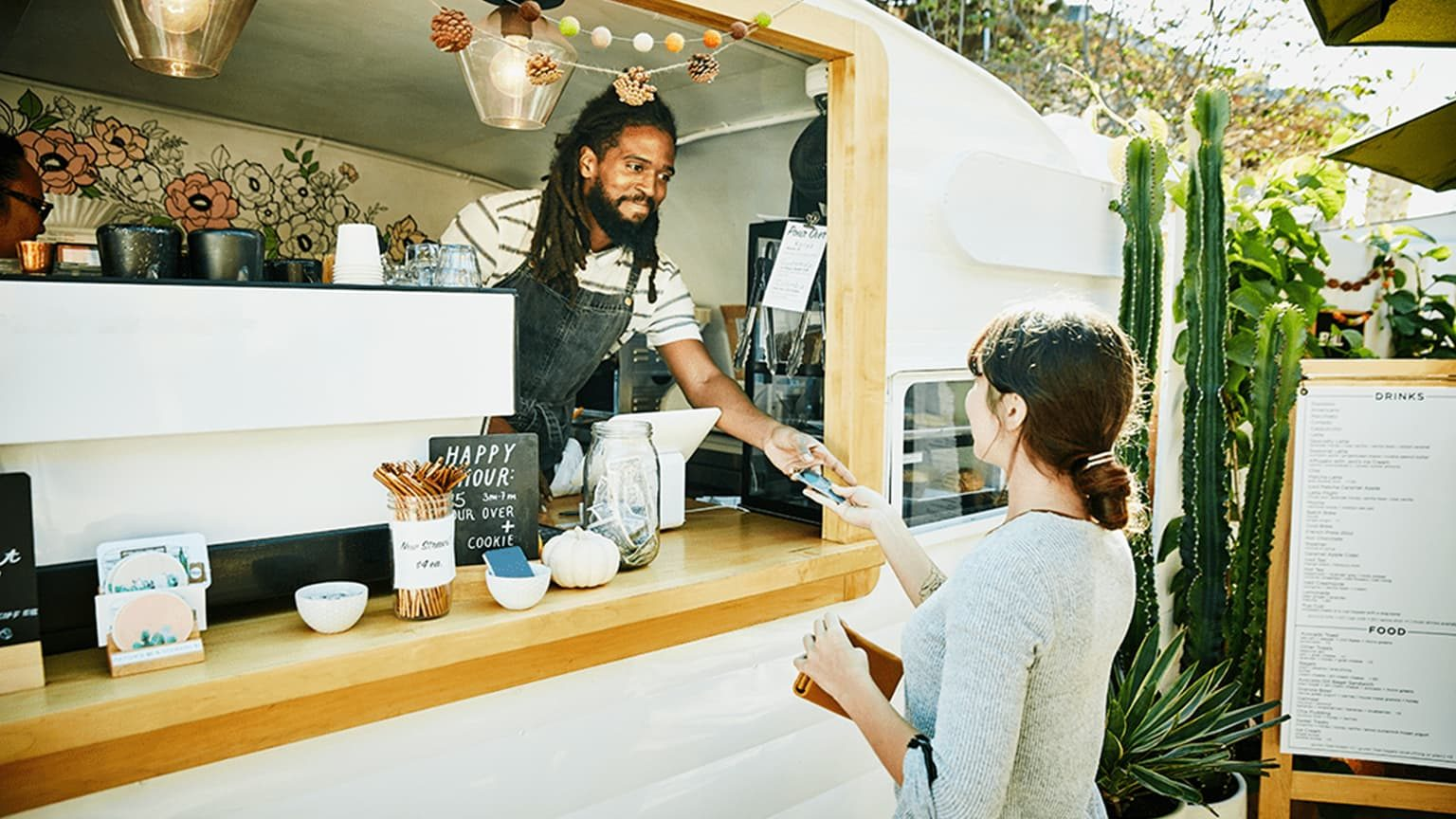Businessman and customer in kiosk