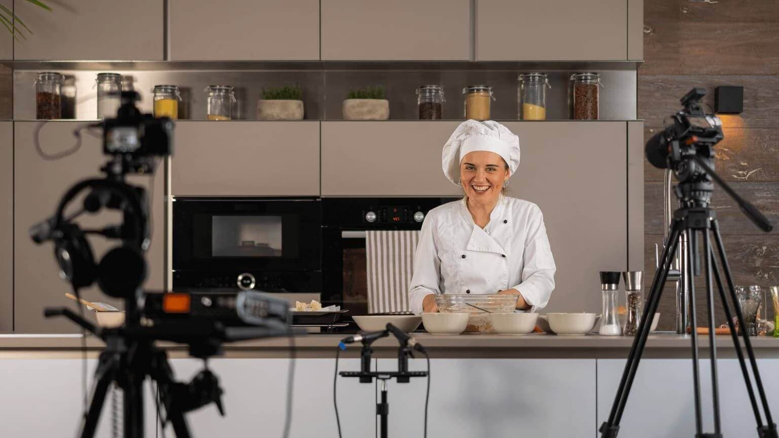 female chef smiling on kitchen studio set