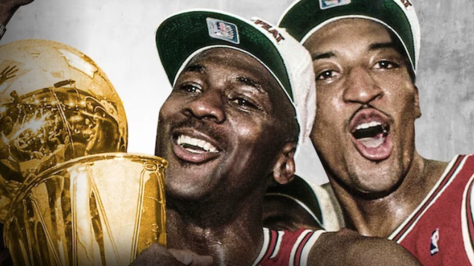 Michael Jordan and Scottie Pippen celebrating with Larry O'Brien trophy