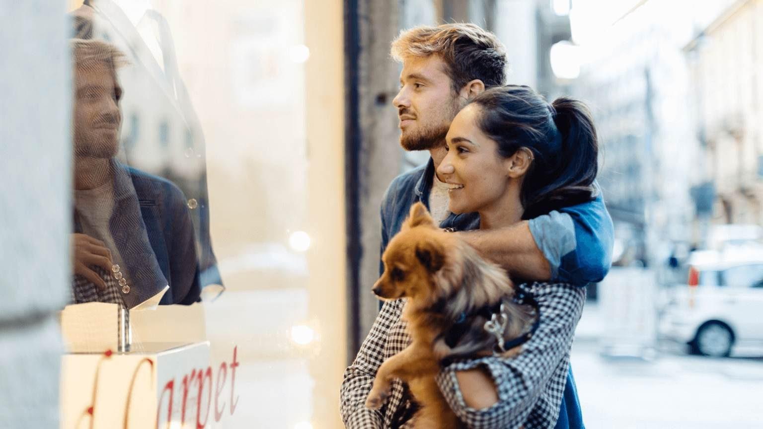 Couple holding a dog