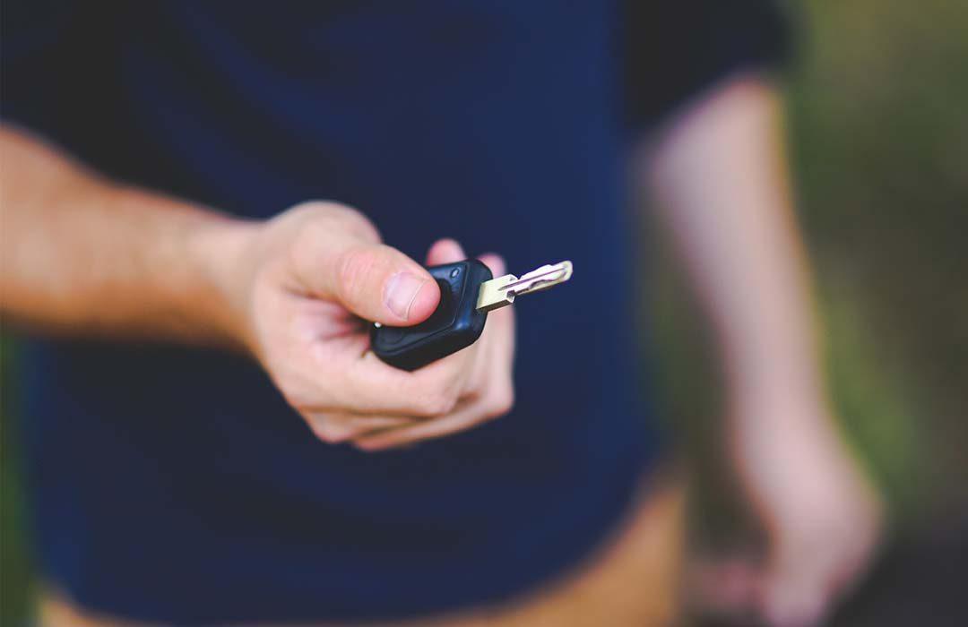 Man holding a car key