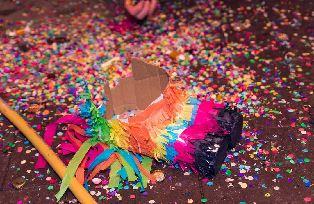 Colorful Piñata on the floor and candies