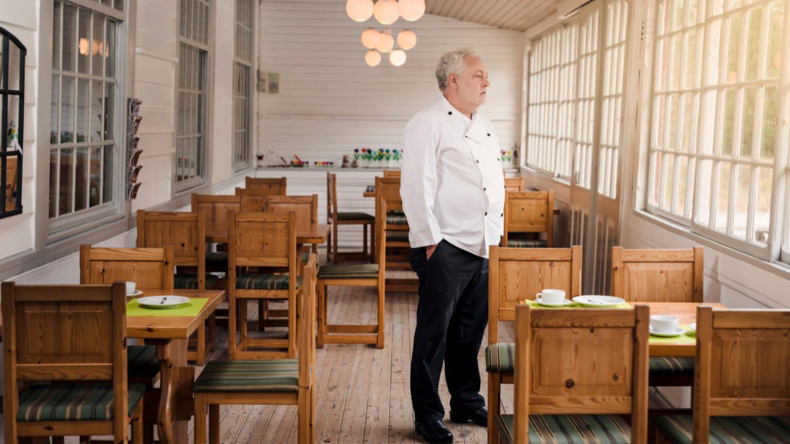Man standing in his empty business during coronavirus pandemic