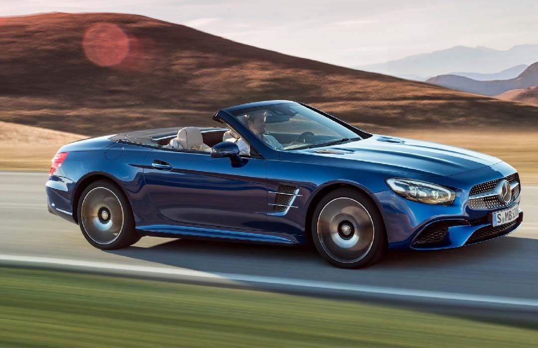 Blue Mercedes benz SL on the road