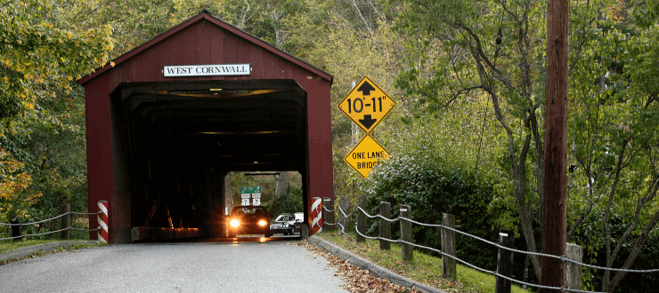 A classic piece of Americana, a covered bridge in West Cornwall,Connecticut. Shot on a autumn day with a Canon 5D in RAW mode and converted to JPEG for submission.