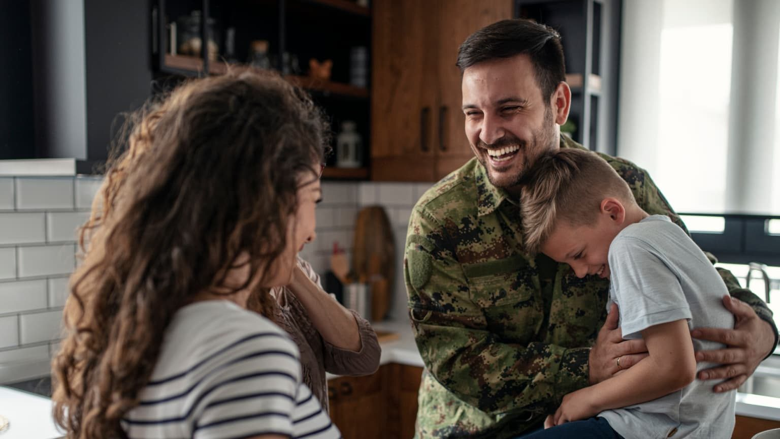 American soldier with happy family at home