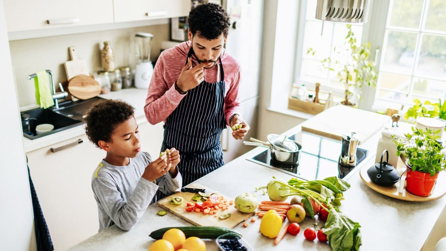 Dad cooking with son