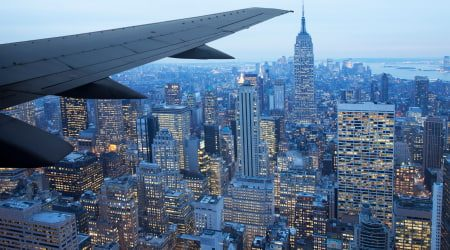 AeroplaneWingOverCity_GettyImages_450x250