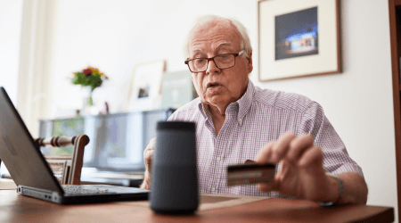 ElderlymanWithCreditCardComputer_GettyImages_450x250