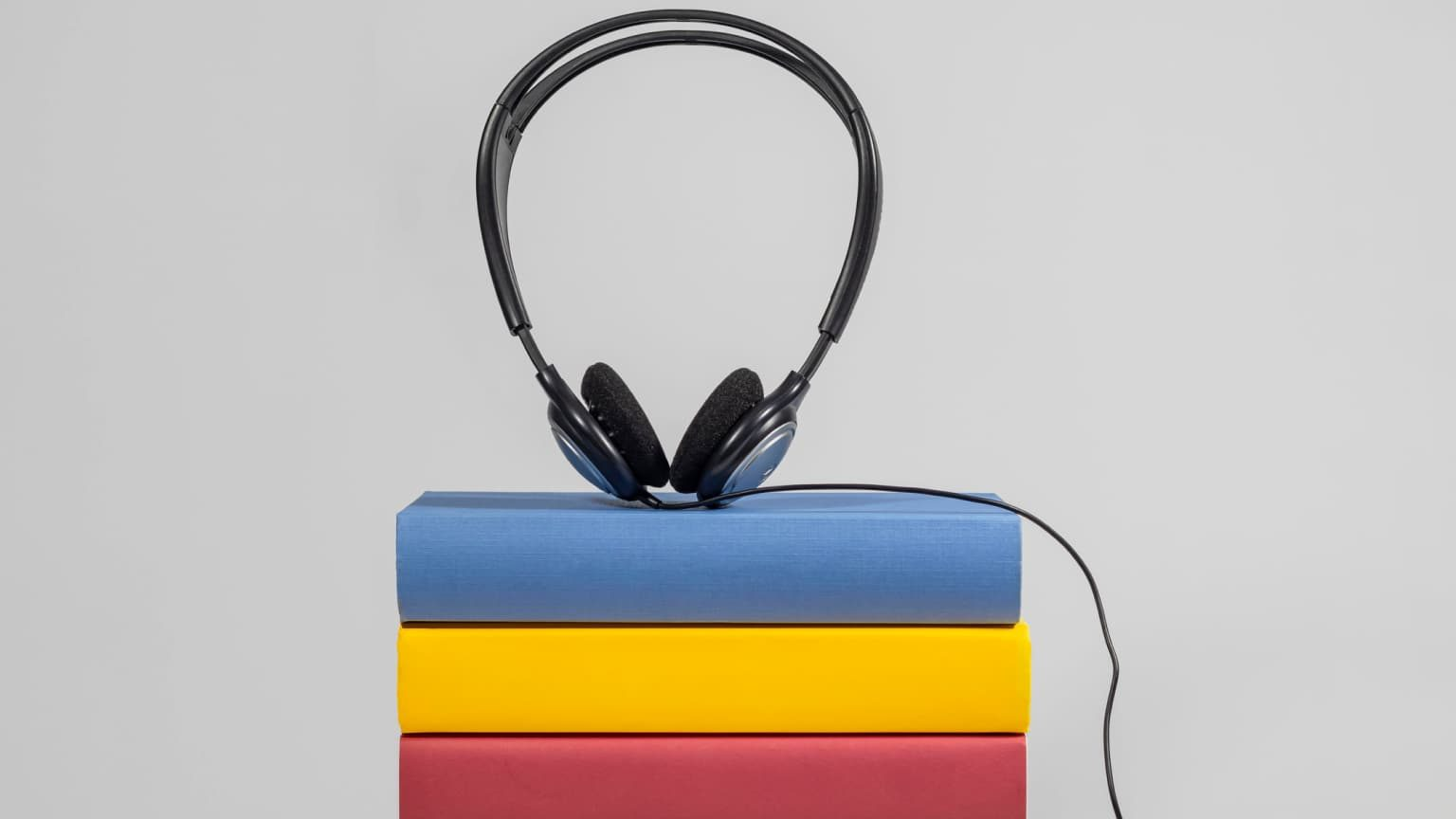 headphones over colored books