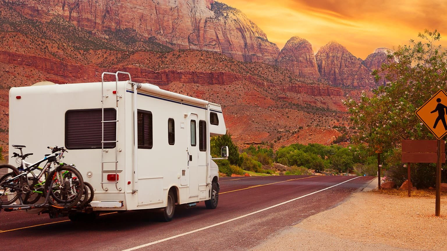 RV on the road with mountain background