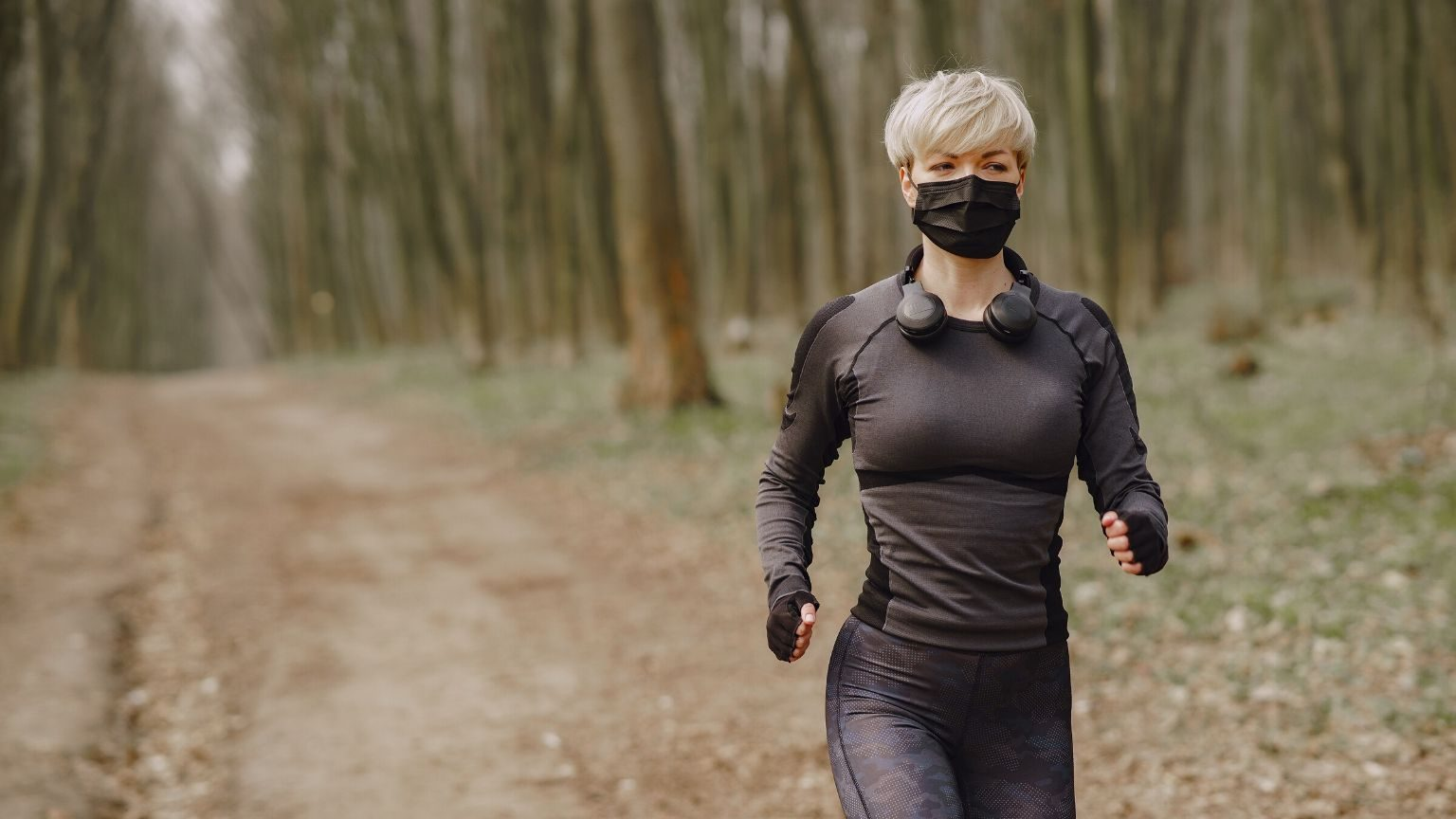 Woman running while wearing face mask