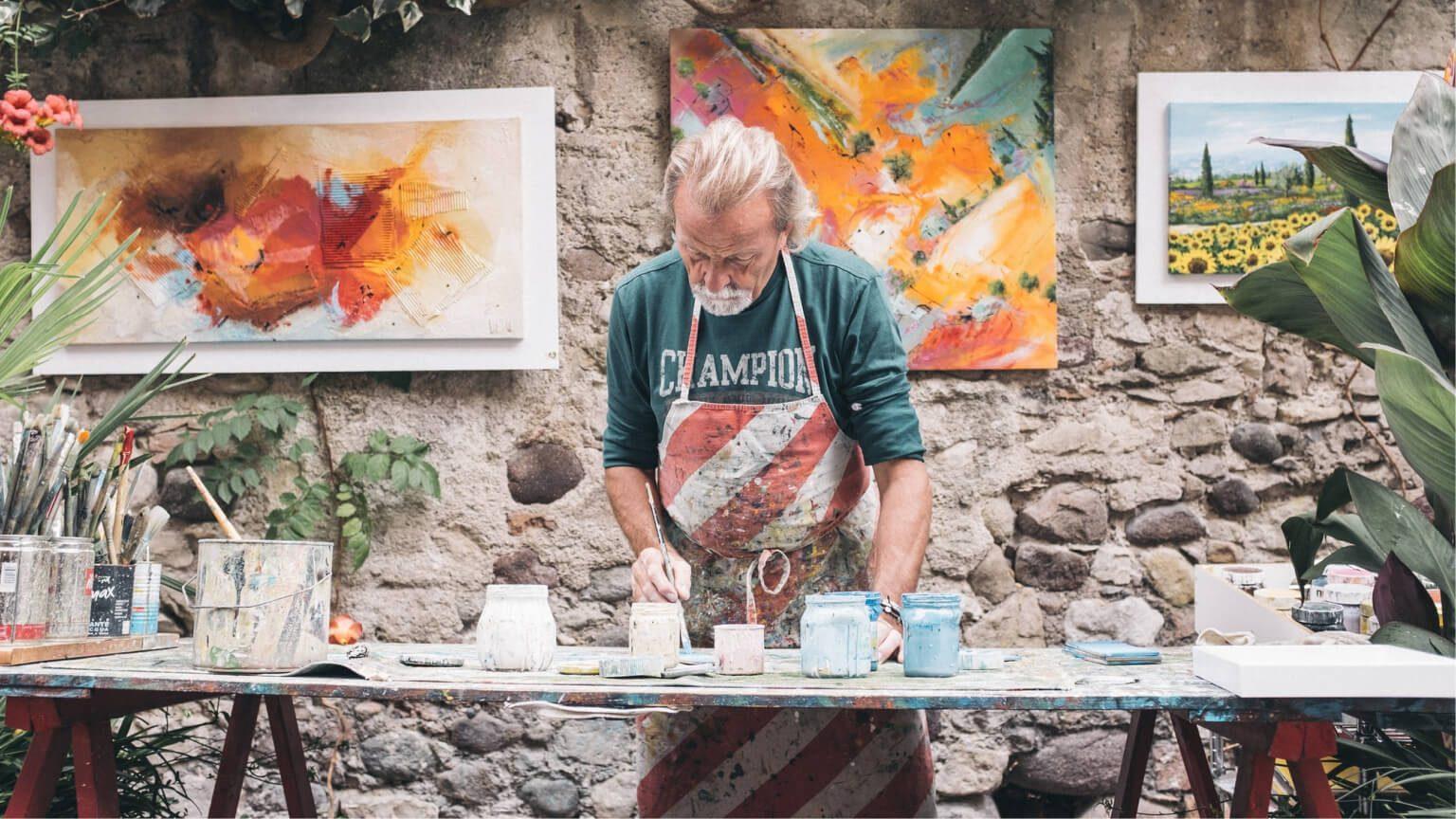 elderly man working on art business