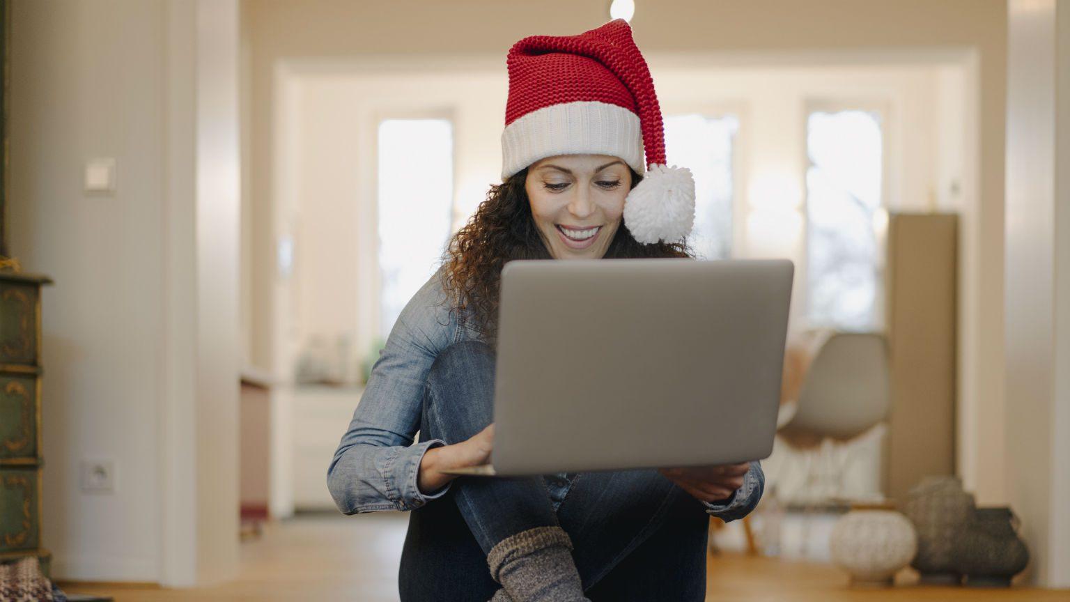 Women shopping online in Christmas hat