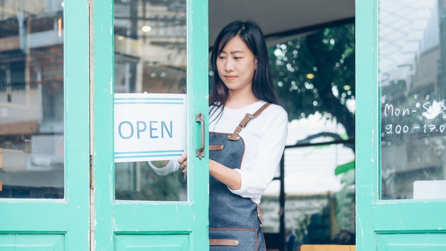 Woman with open business sign