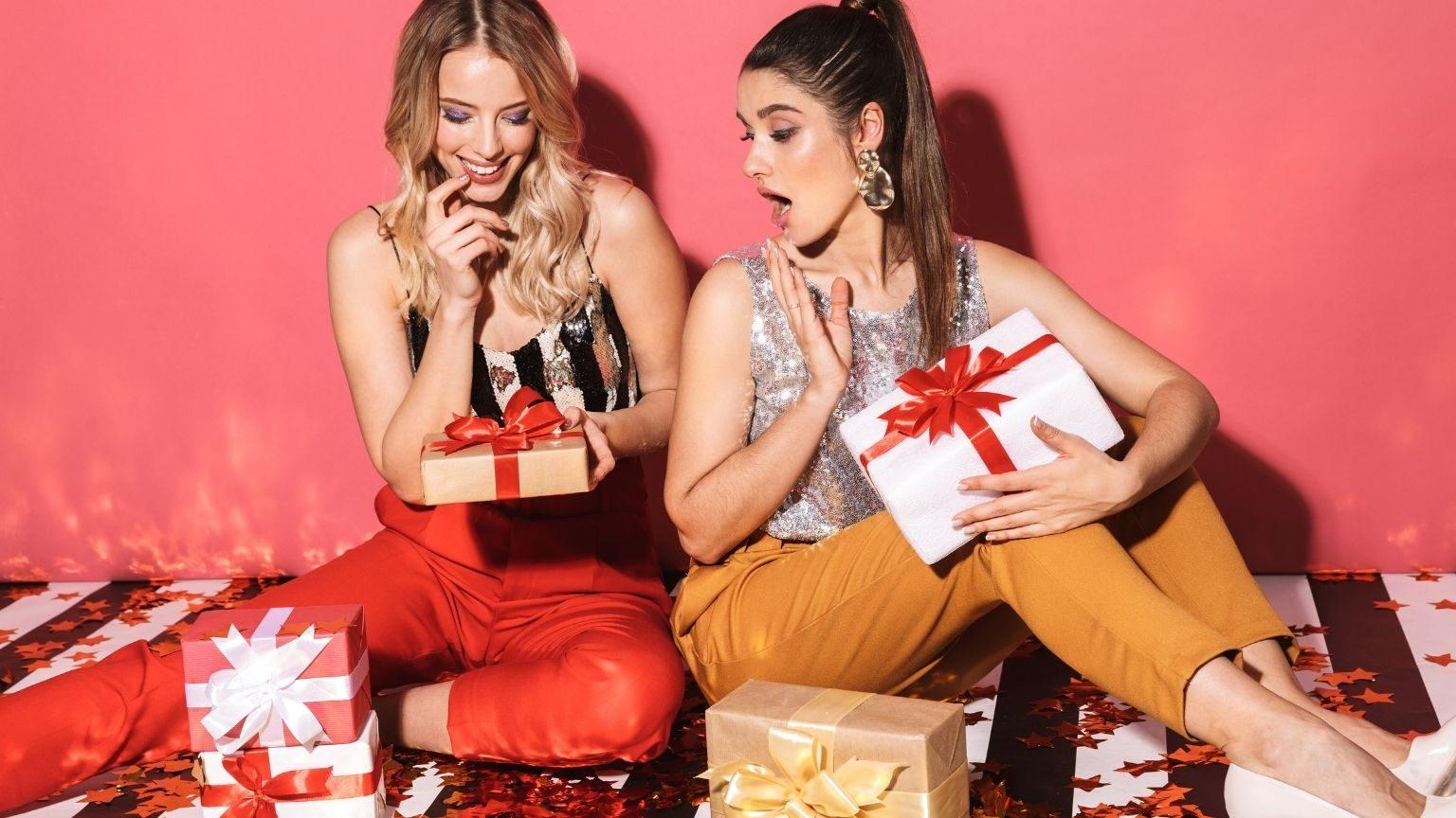 Girls unwrapping fashion presents