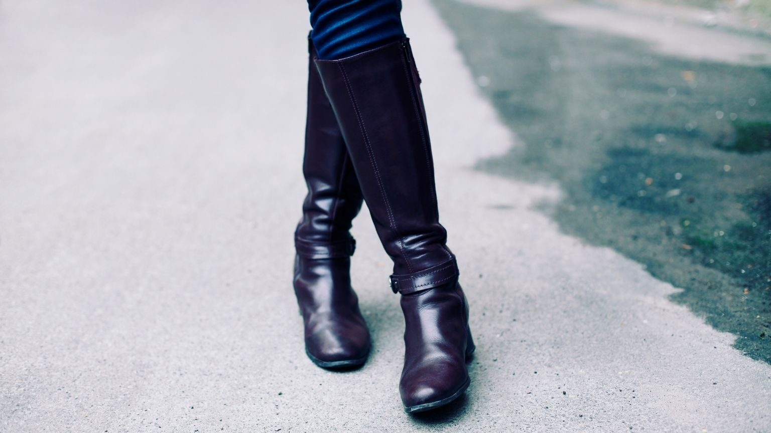 Woman wearing leather boots outside