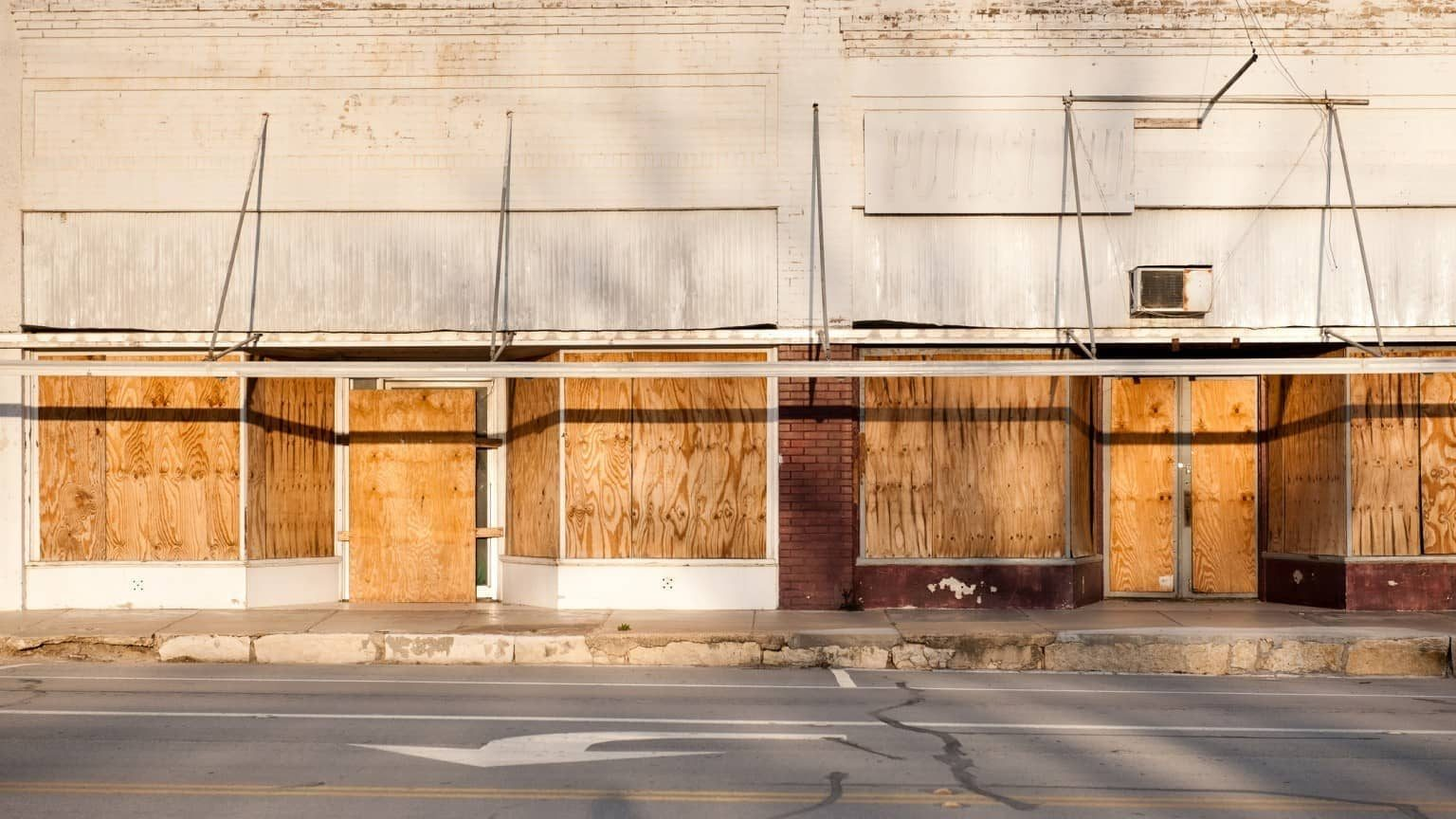 businesses whose windows are boarded up