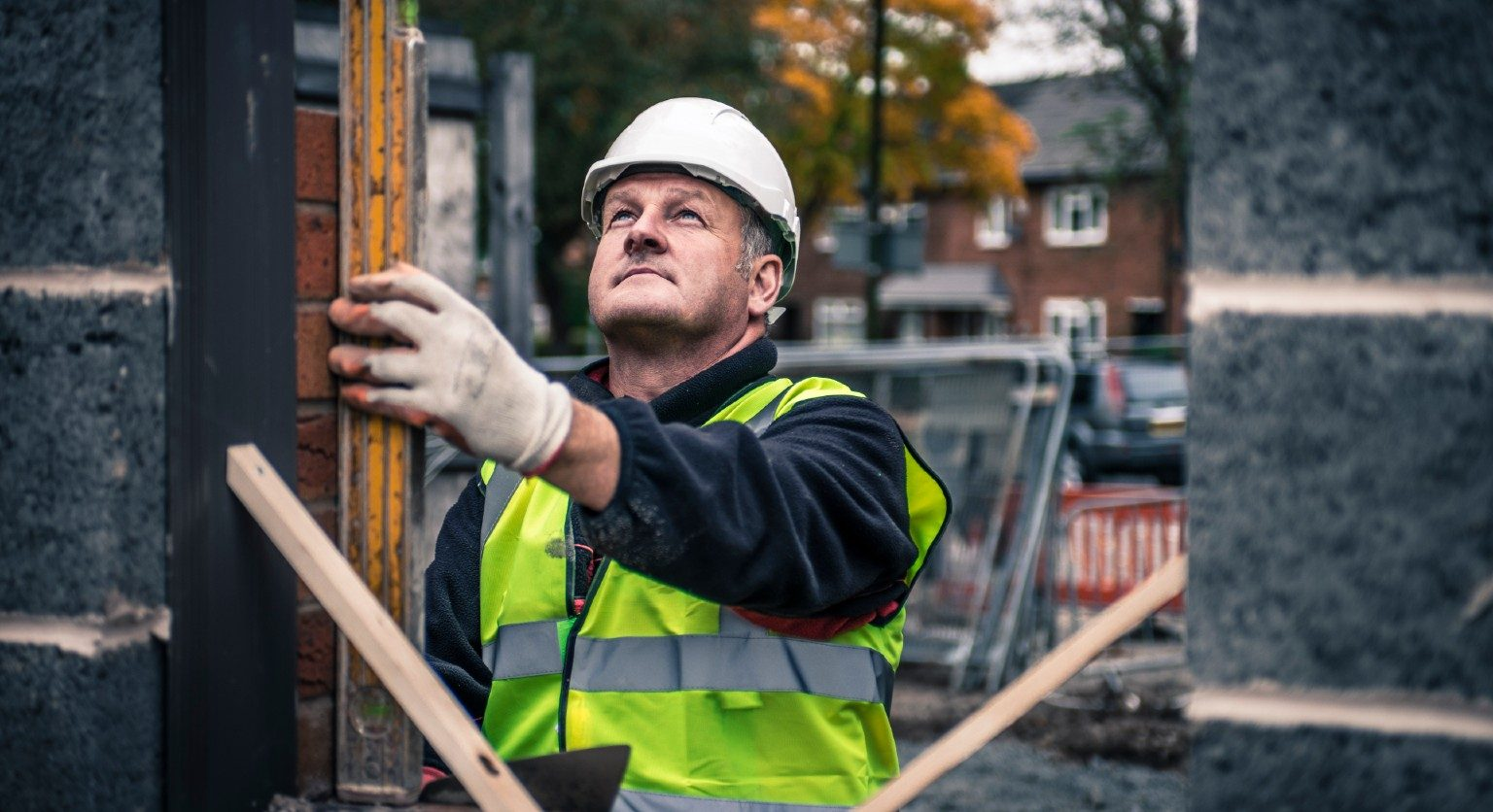 Irish builder on construction site.