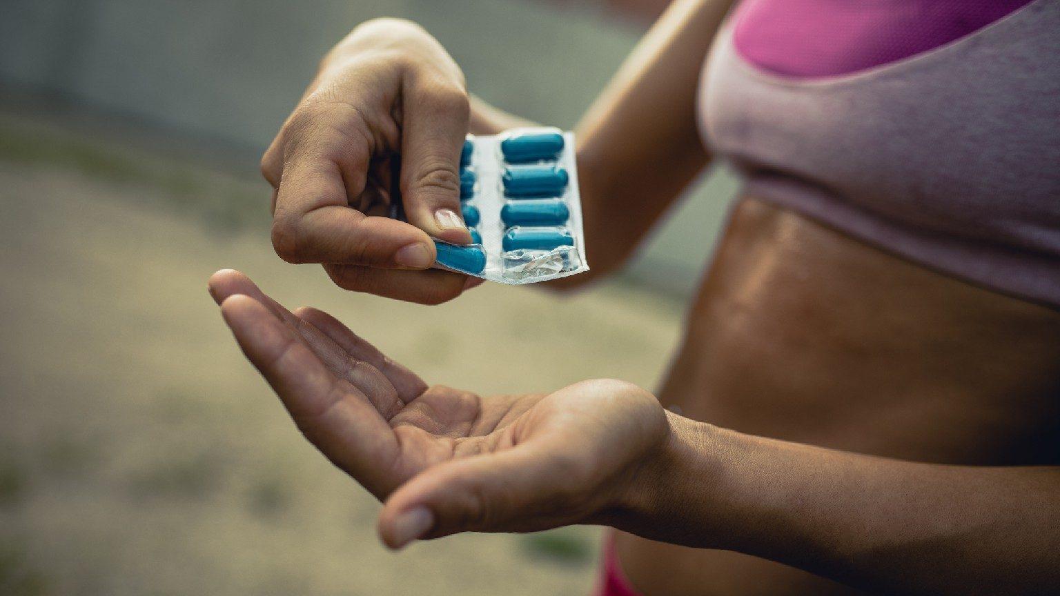 woman taking probiotics
