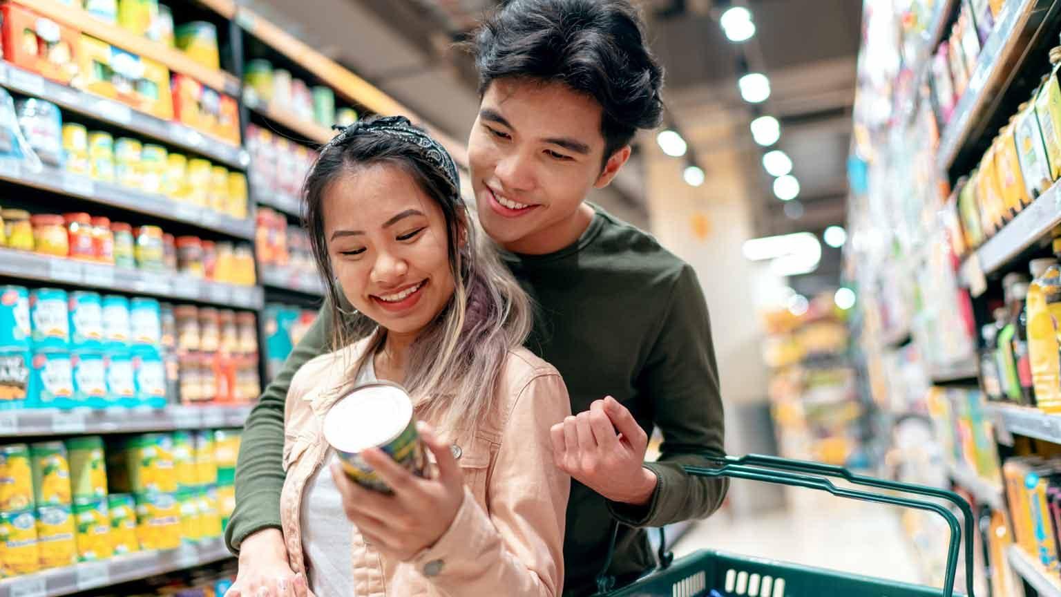 Couple shopping in supermarket Singapore