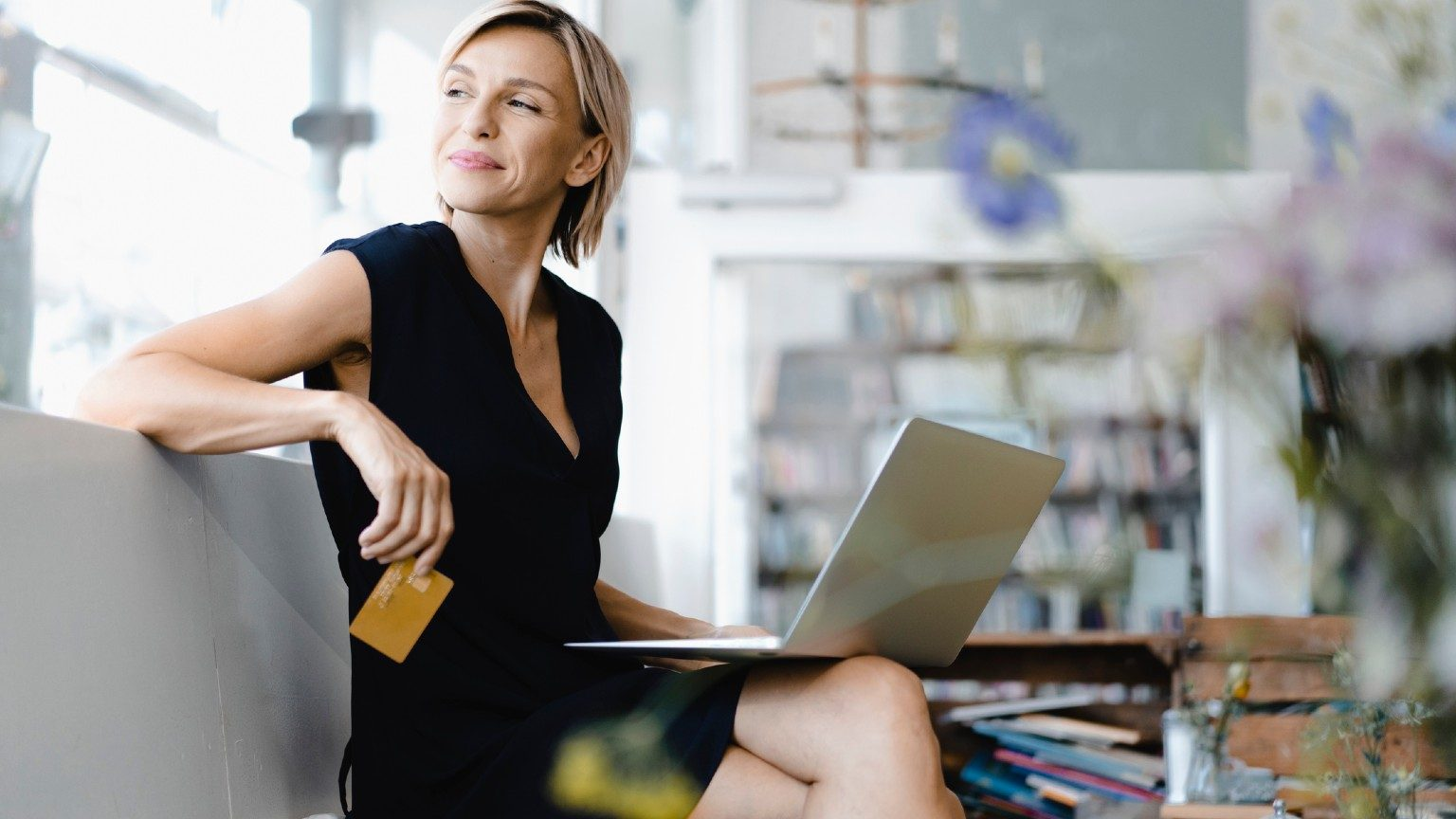 Woman with card and laptop