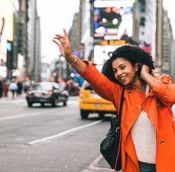 young woman hailing cab